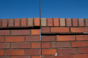 Damaged brick wall.