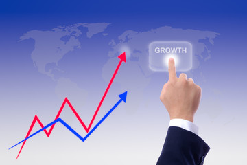 hand pushing growth button and graph