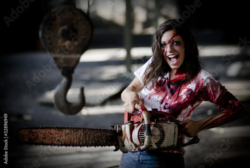 Psychotic woman with a bloody chainsaw.Vendetta/blood revenge.