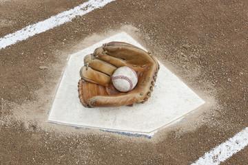 A baseball glove on homeplate