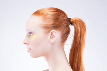 Beautiful profile of red-haired woman