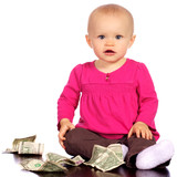 Infant baby girl playing with money