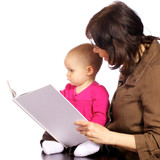 Infant baby girl discovering books with grandma