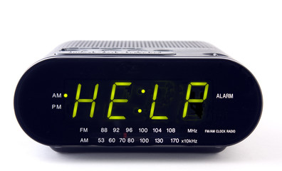 Digital alarm clock with the word HELP