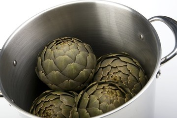 Steamed artichokes in a large pot