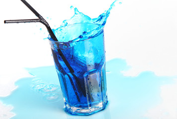 Blue cocktail with splashes isolated on white