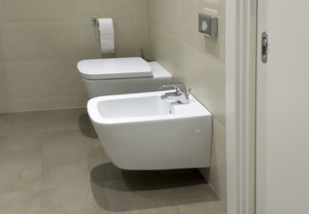 Toilet and bidet in hotel bathroom