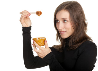 smiling young woman with bowl of honey