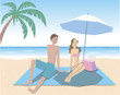 海辺でくつろぐカップル