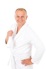 Male cosmetics - mature man in white bathrobe