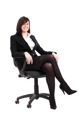 Smiling businesswoman sitting on a char on white background