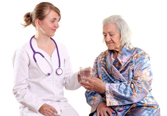 Doctor gives a glass of water to her patient
