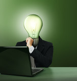 businessman with lamp-head with laptop