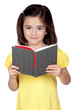 Brunette little girl reading a book