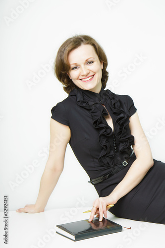 smiling attractive young businesswoman with a notebook
