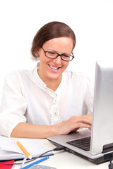 Smilling girl looking in laptop
