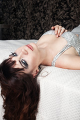 young girl in a silver dress resting in a hotel