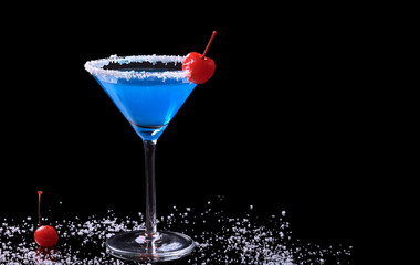 Blue Curacao with coconut flake and maraschino cherry