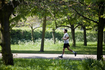 A young man running in the park