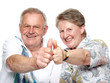 Closeup portrait of a smiling elderly couple showing thumps