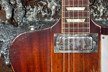 Well Worn Guitar Against Grungy Metal Background