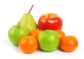 fruit plate with citrus fruits, apples, banana, plum