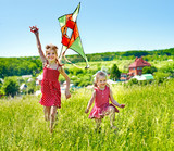 Kids flying kite outdoor.