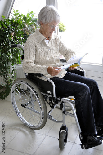 Older Woman in Wheelchair reading