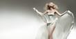 Beautiful sexy young woman wearing white dress