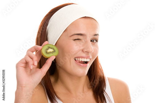 Woman with slice of kiwi