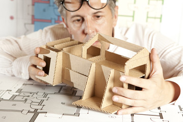 Architect with model house