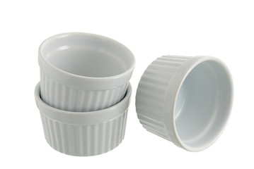 Three white ceramic individual baking pans