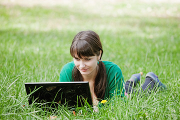 sexy girl with a laptop in the grass