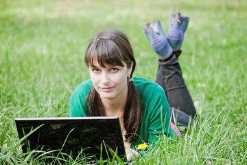 young girl with a laptop