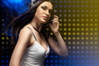 beautiful woman dj wearing headphones