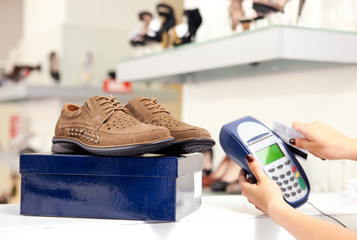 Paying with credit card in shoe store