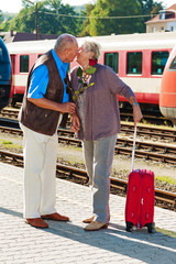 Mature aged couple at the train station