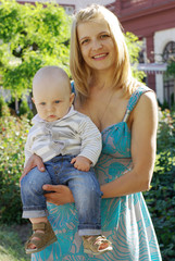 Beautiful woman with a baby