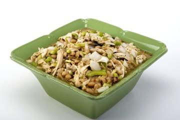 White chicken chili in green ceramic dish