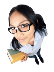 A nerdy Asian girl holding a book shot with a wide angle lens