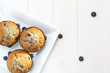 three muffin on a white square plate, white table