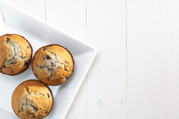 blueberry muffin on a sqare plate