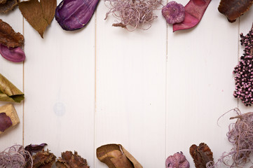 potpourri frame on wooden background