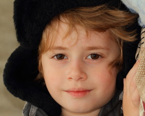 Portrait of a beautiful boy in winter hat