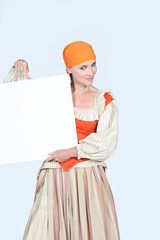 Woman pointing to a blank poster