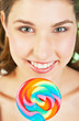 Teenager girl with lollipop