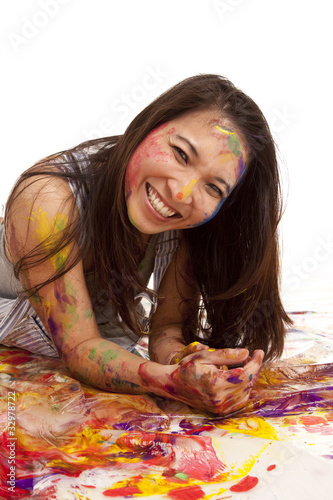 laying in paint smile
