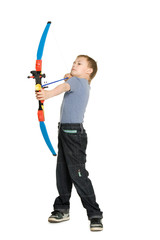 Blonde boy shooting a bow