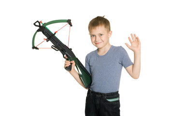 Smiling boy holding a crossbow