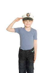 Boy in the sea cap salutes. His cap emblem of Russia.